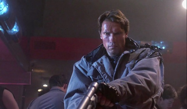 The Terminator T-800 raises his gun to fire in the club
