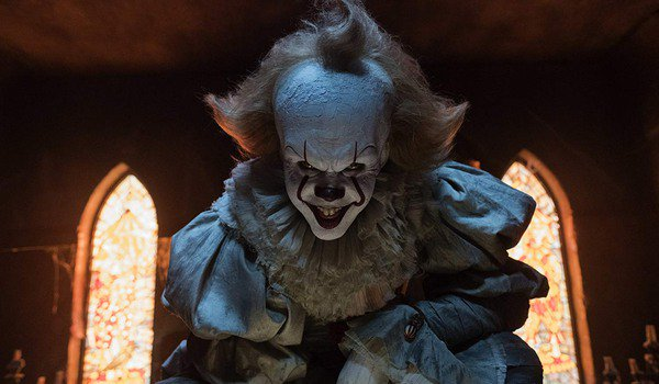 IT Pennywise grinning in the Neibolt Street house