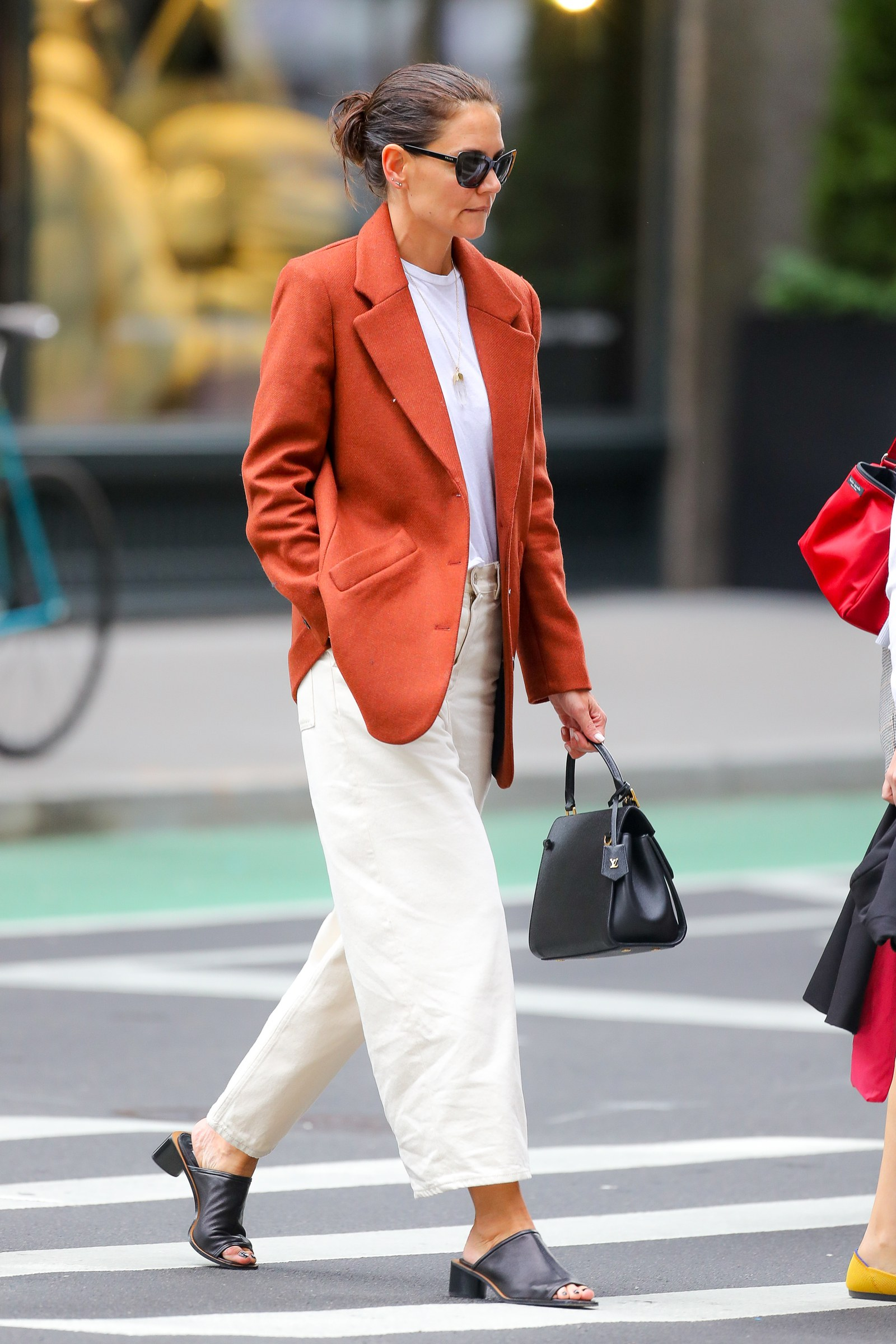 Katie Holmes sip into her coffee while taking stroll in New York City Katie was spotted taking a walk around Fifth...