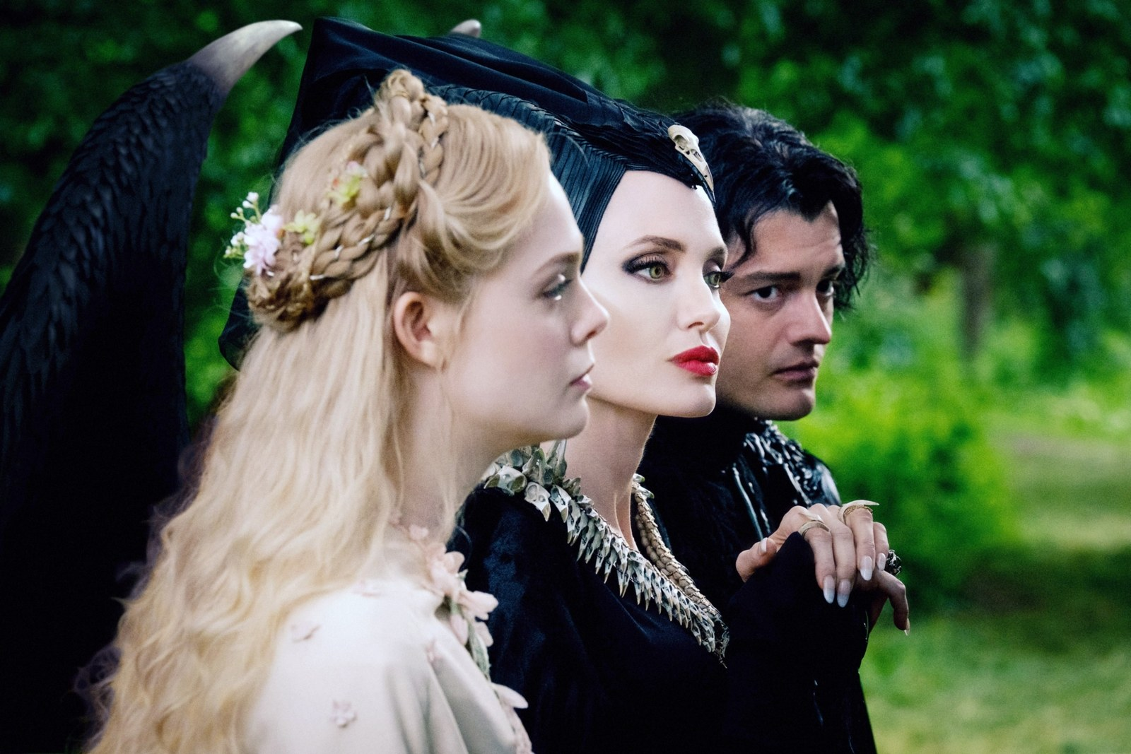 Elle Fanning as Aurora Angelina Jolie as Maleficent Sam Riley as Diaval in Maleficent