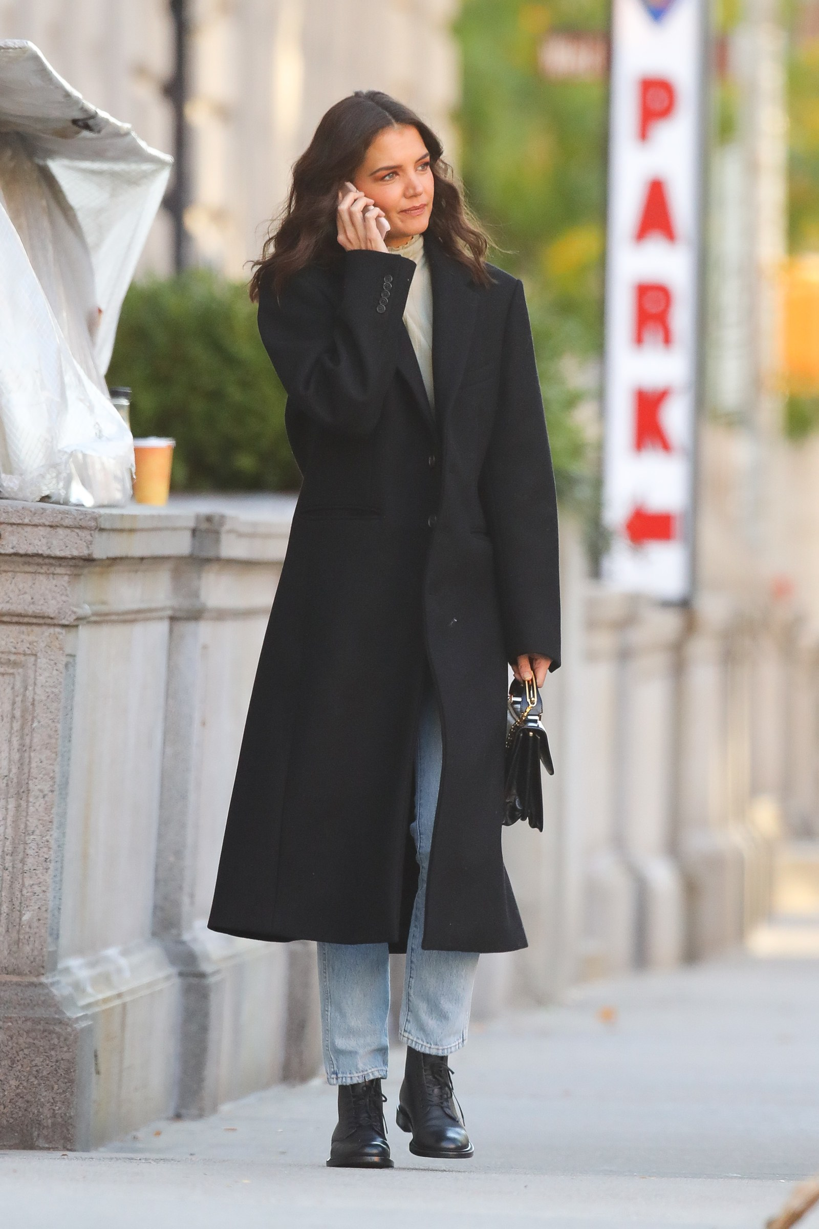 Katie Holmes talking on phone and wearing a peacoat and jeans