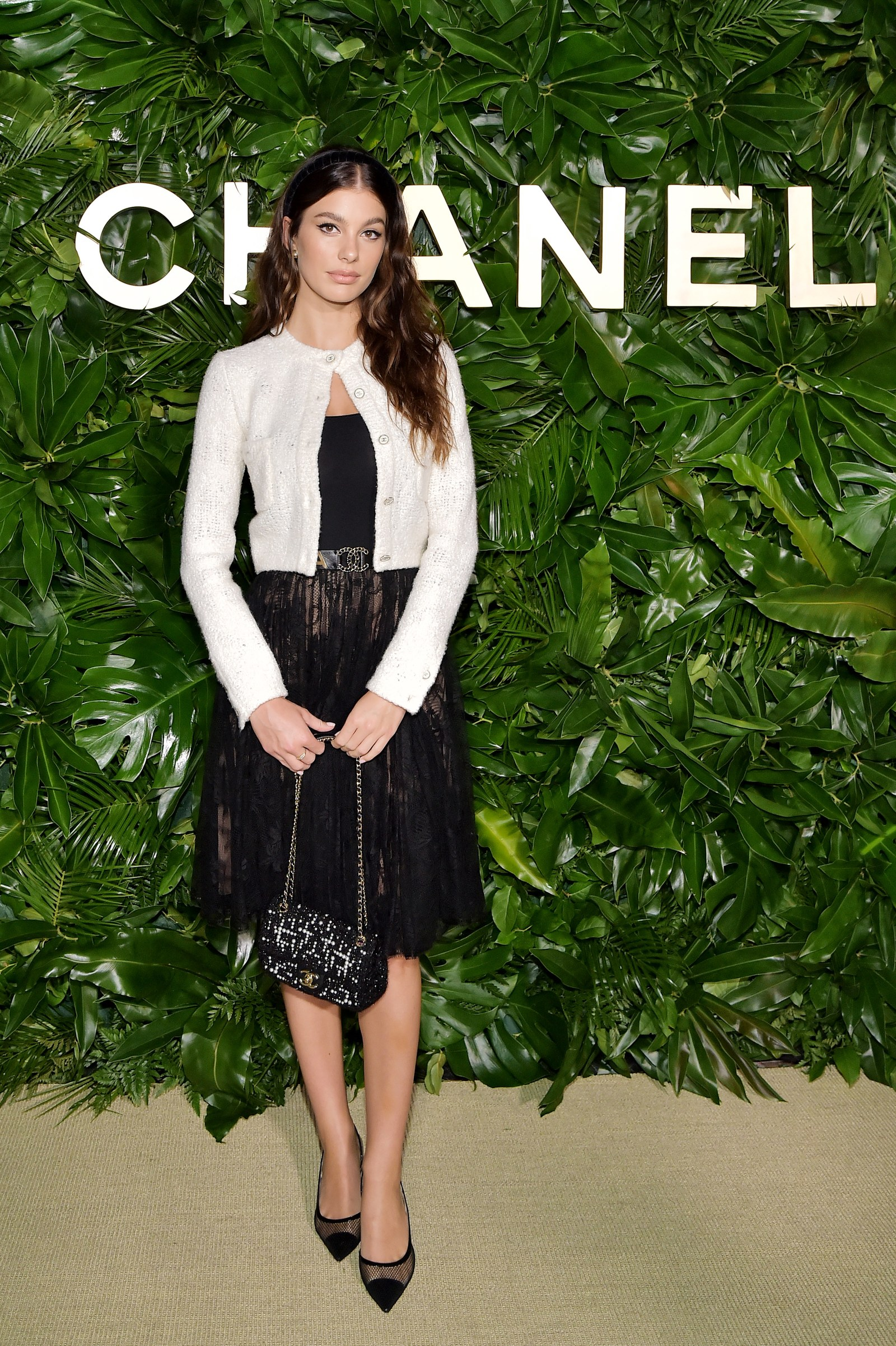 Camila Morrone wearing CHANEL attends Chanel Dinner Celebrating Gabrielle Chanel Essence With Margot Robbie on September...