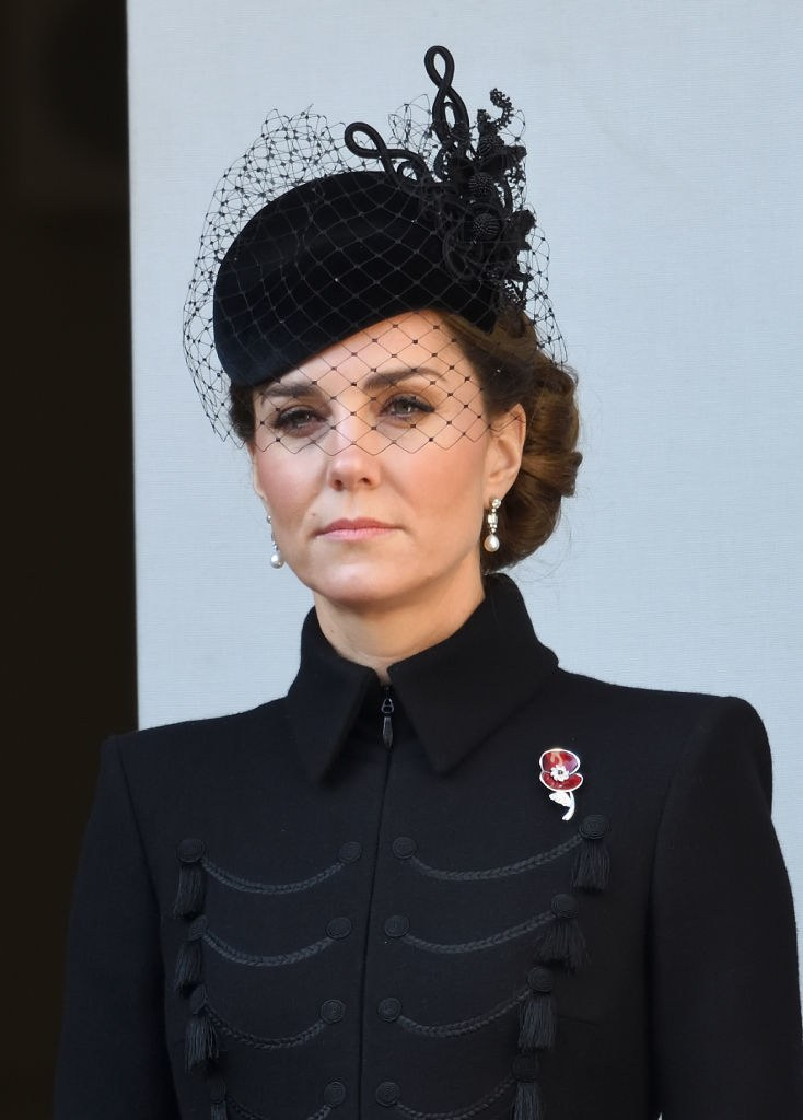 pKate Middleton wears a red poppy pin to honor her grandmother at Cenotaph memorial.p