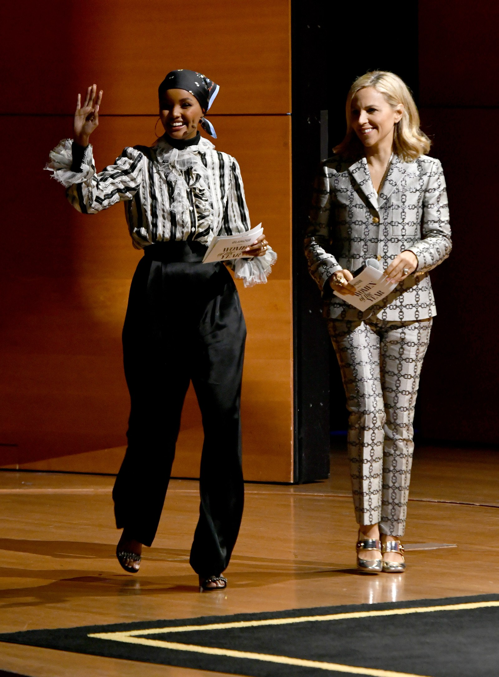 Halima Aden and Tory Burch speak onstage during the Repeat After Me Embrace Your Ambition panel at the 2019 Glamour...