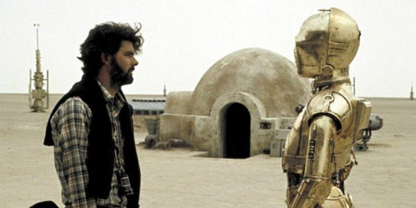 George Lucas directs C-3PO on the set of Star Wars