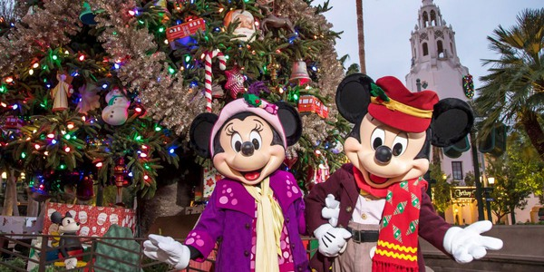 Mickey and Minnie Characters in front of Christmas tree