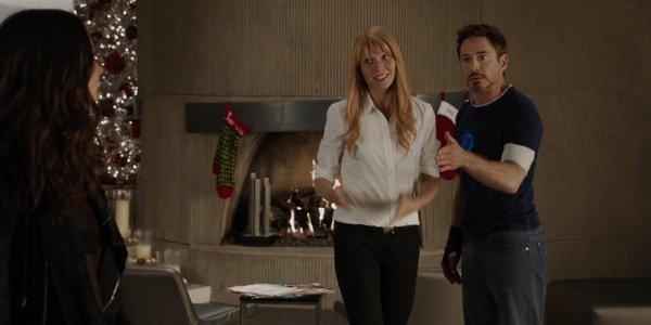 Iron Man 3 Tony and Pepper try to talk to Maya in front of the fireplace