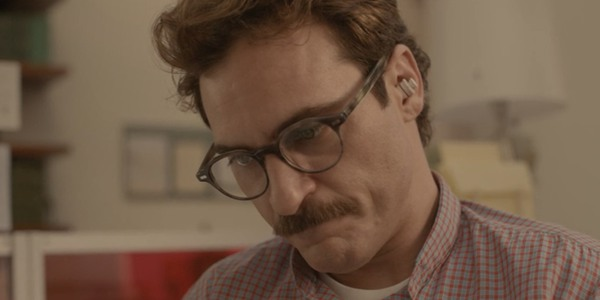Joaquin Phoenix enjoying his time with Scarlett Johansson's voice in Her