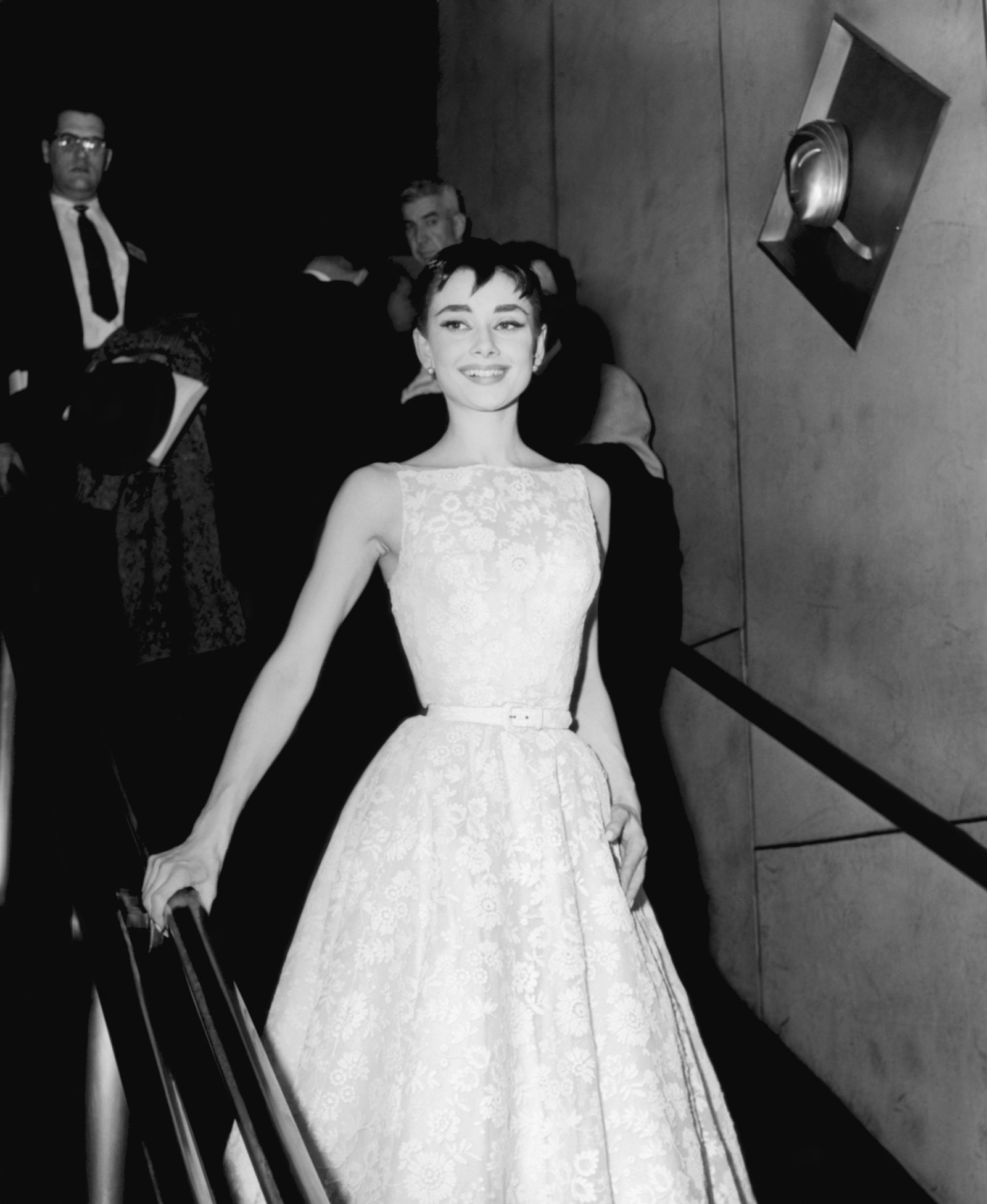 Audrey Hepburn style Audrey Hepburn wears a white lace dress at the 26th Academy Awards