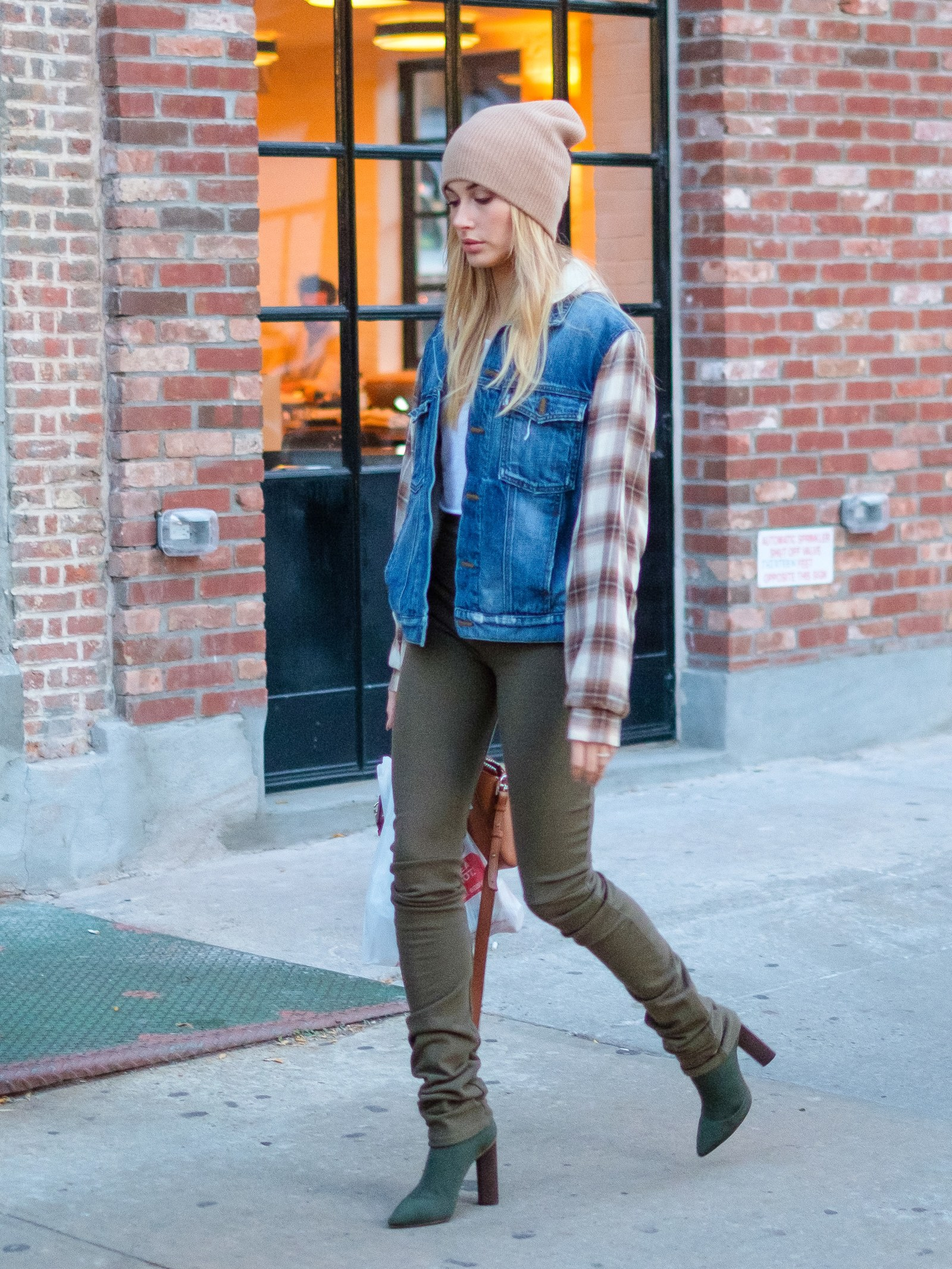 How to wear flannel Hailey Baldwin wears denim and flannel in New York City