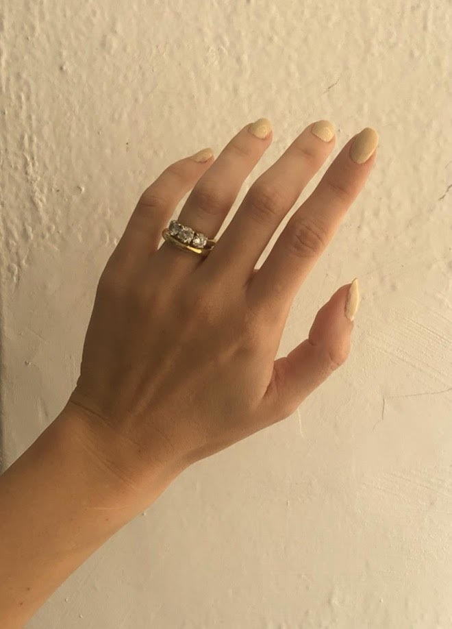 This image may contain Human Person Jewelry Accessories Ring Accessory and Hand