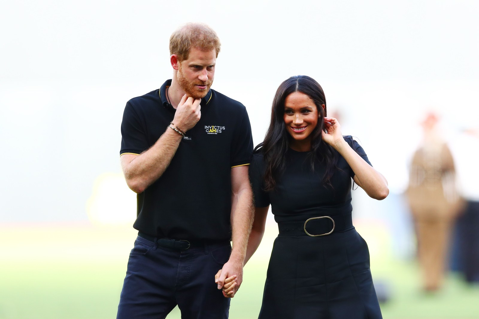 Prince Harry Duke of Sussex and Meghan Duchess of Sussex look on during the pregame ceremonies before the MLB London...