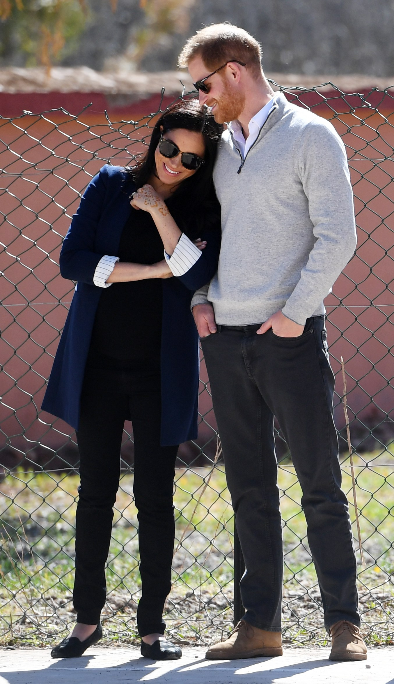 Image may contain Meghan Markle Prince Harry Clothing Apparel Sunglasses Accessories Accessory Shoe Footwear Human...