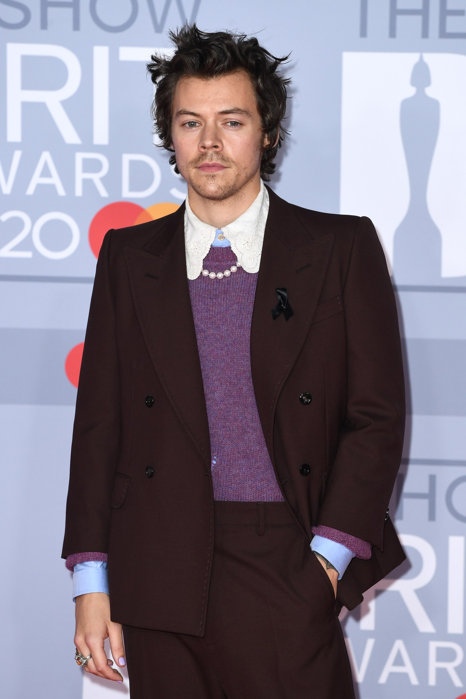 Harry Styles wearing pearls at the Brit Awards