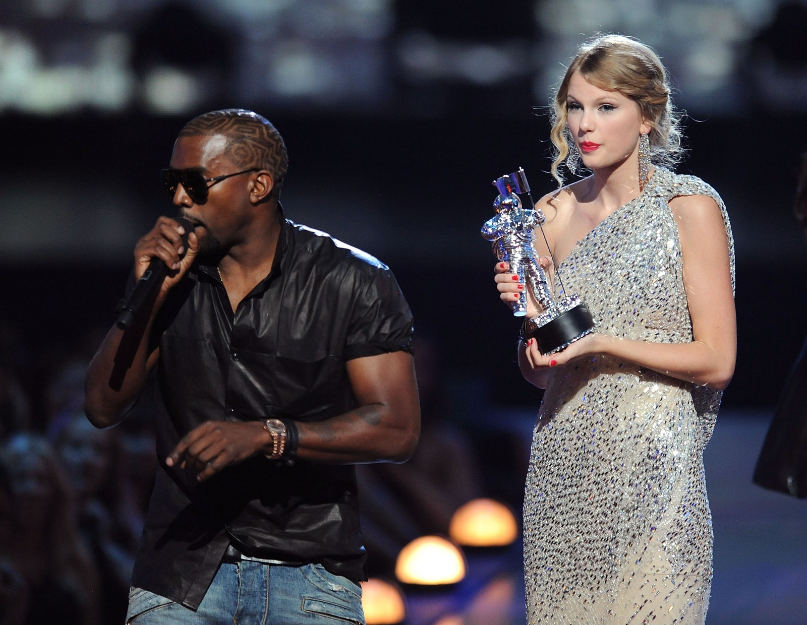 Kanye West takes the microphone from Taylor Swift and speaks onstage during the 2009 MTV Video Music Awards.