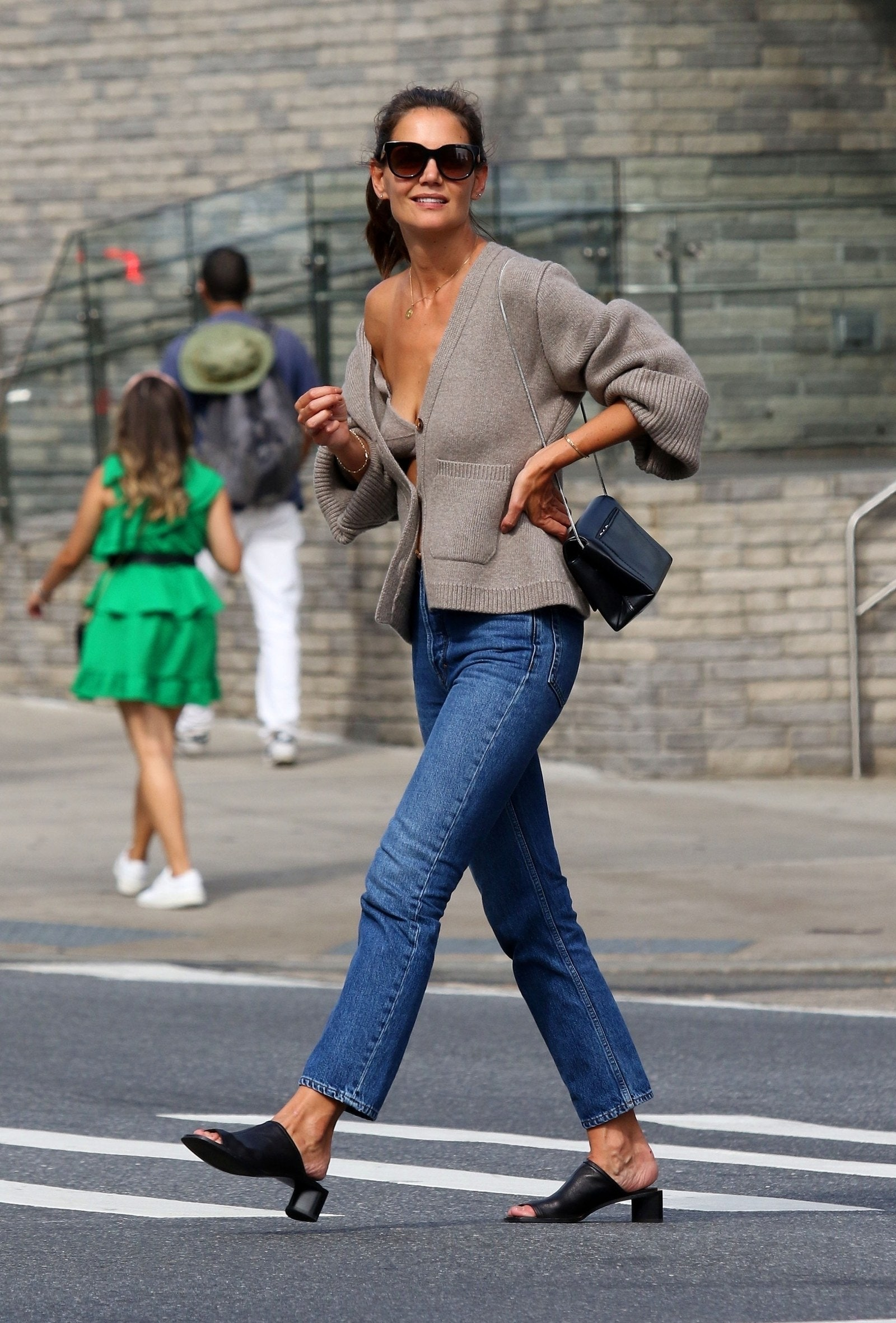 Katie Holmes in a cashmere cardigan and bra