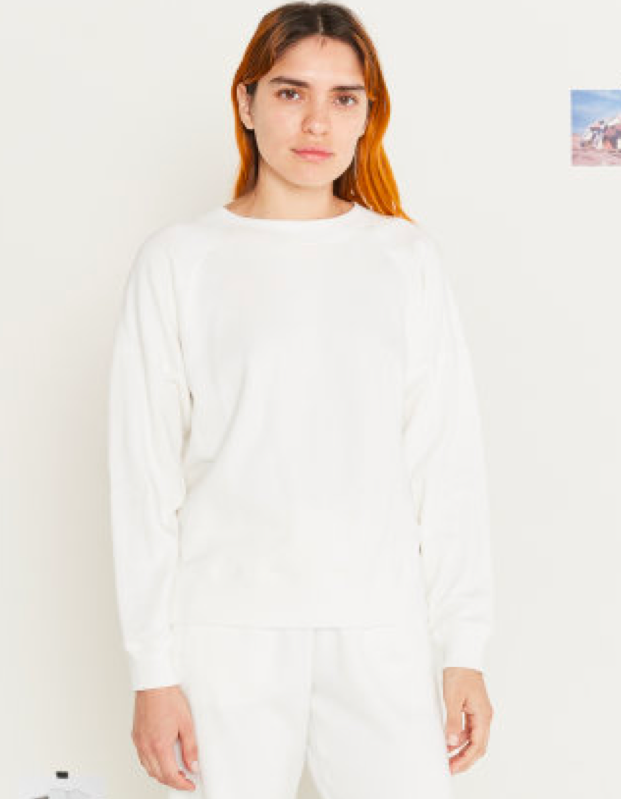 model wearing white sweatshirt