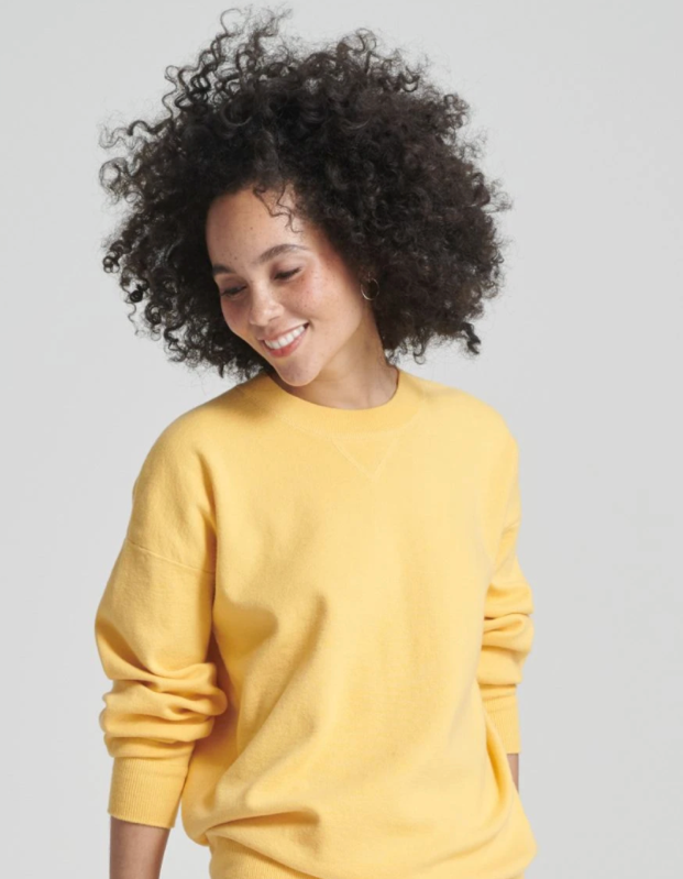 model wearing yellow crewneck