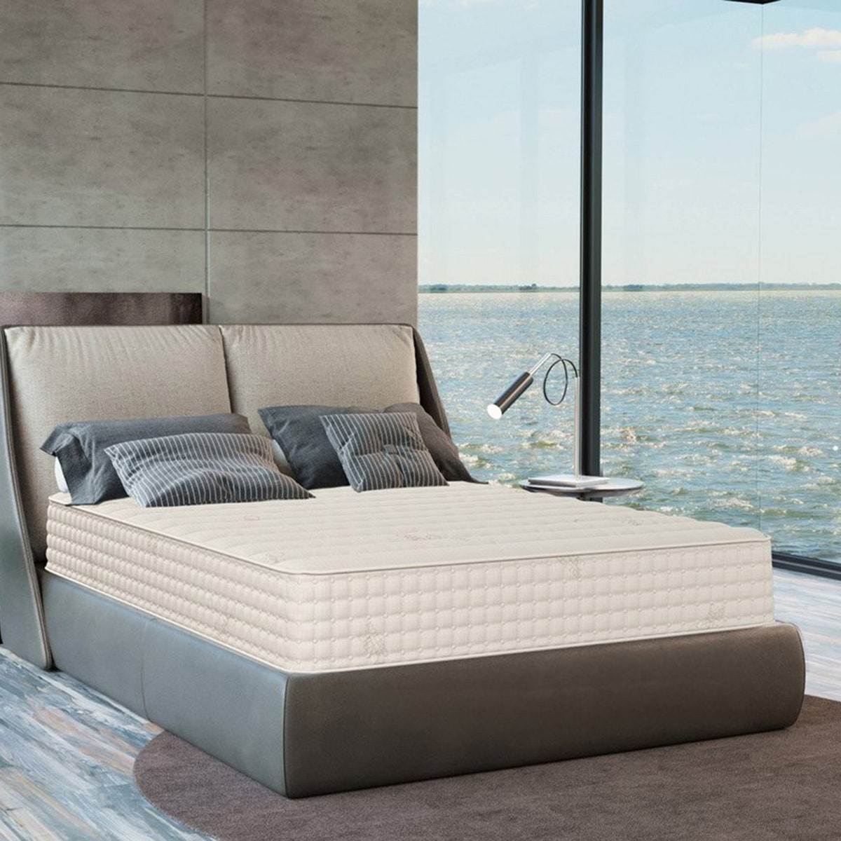 plushbeds organic latex mattress in room with leather bed frame and gray pillows
