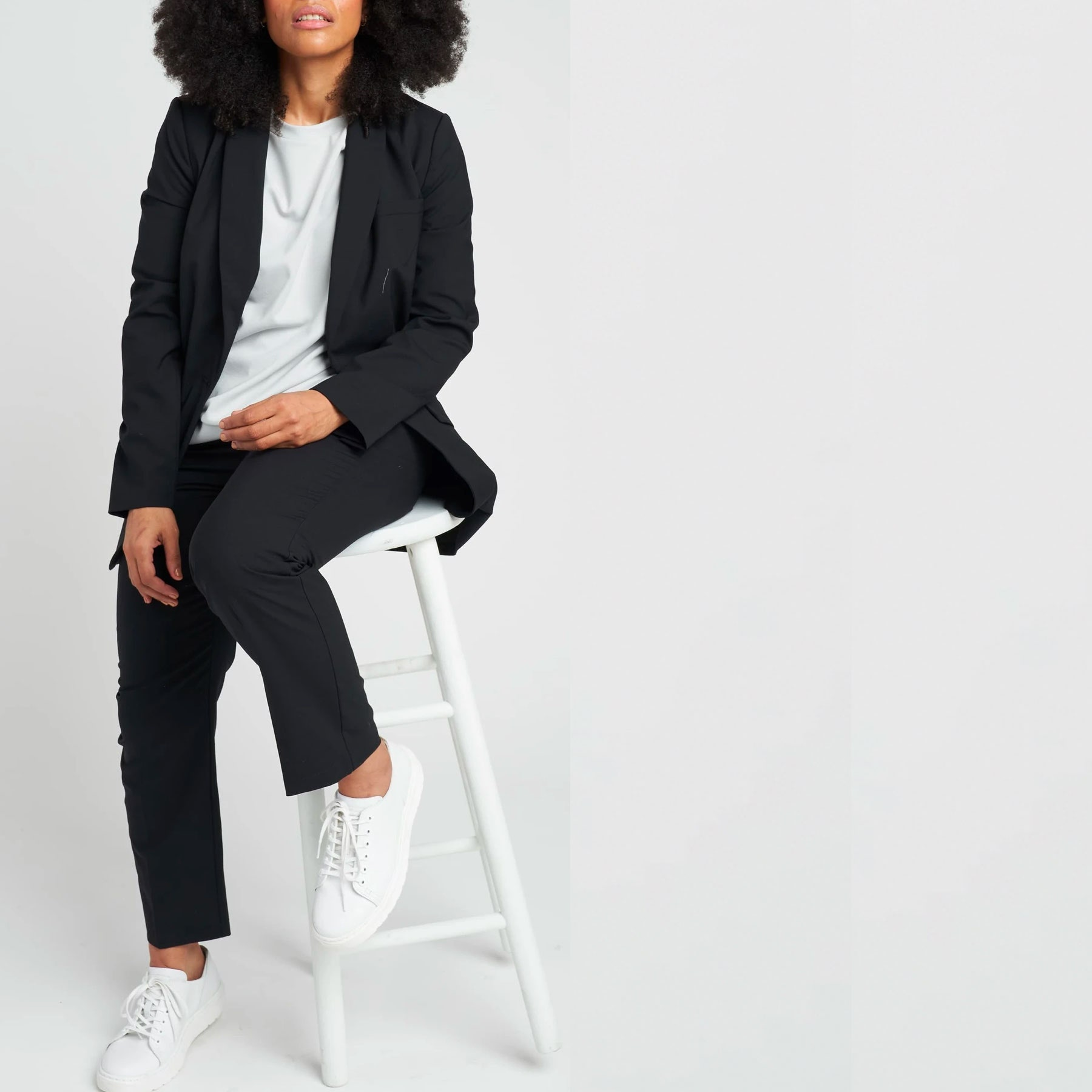 model wearing blazer and trousers