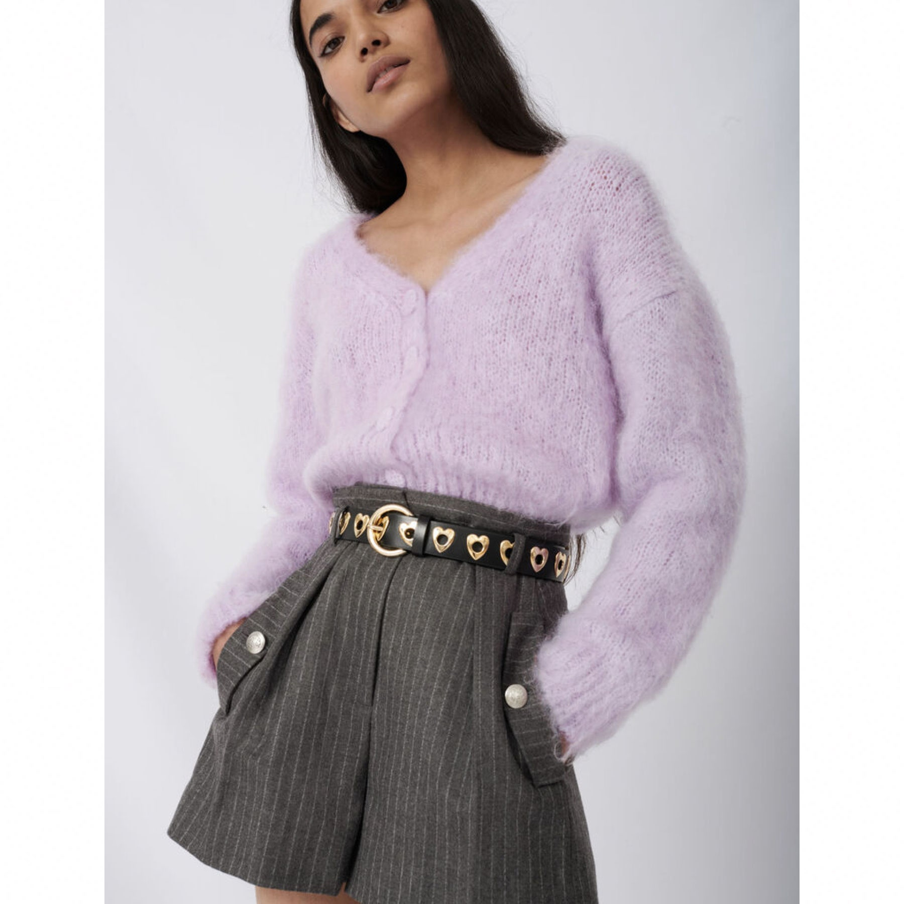 model wearing fuzzy lavender cardigan