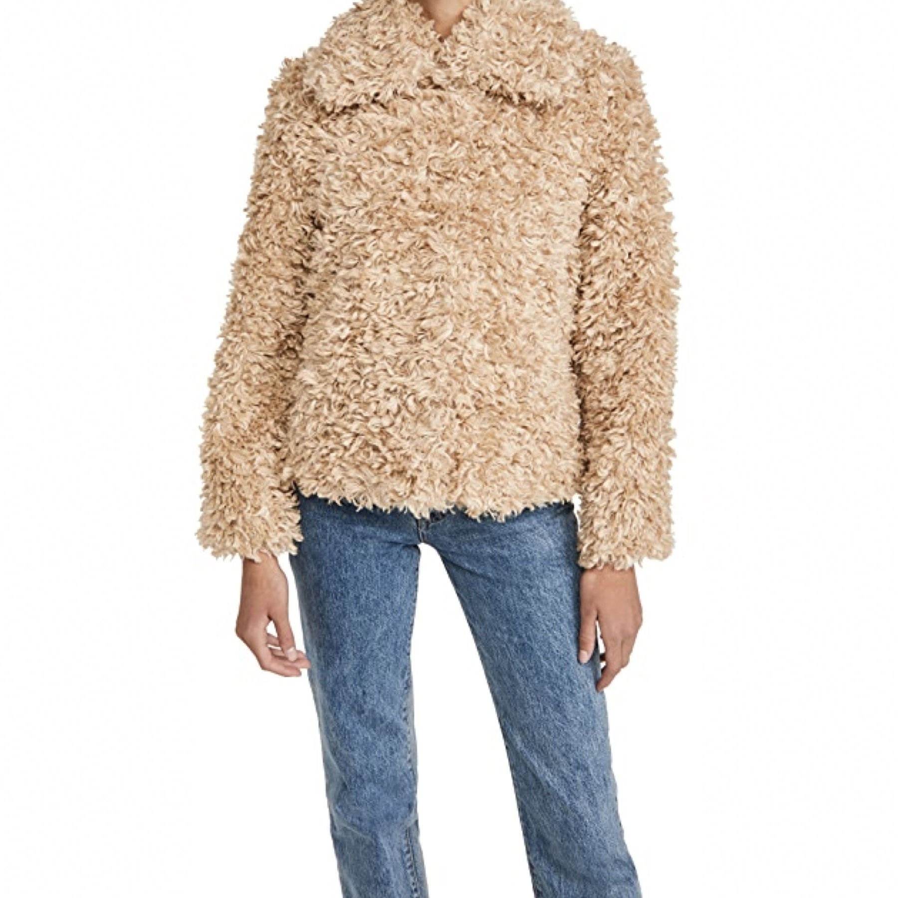 model wearing shaggy beige sweater with jeans