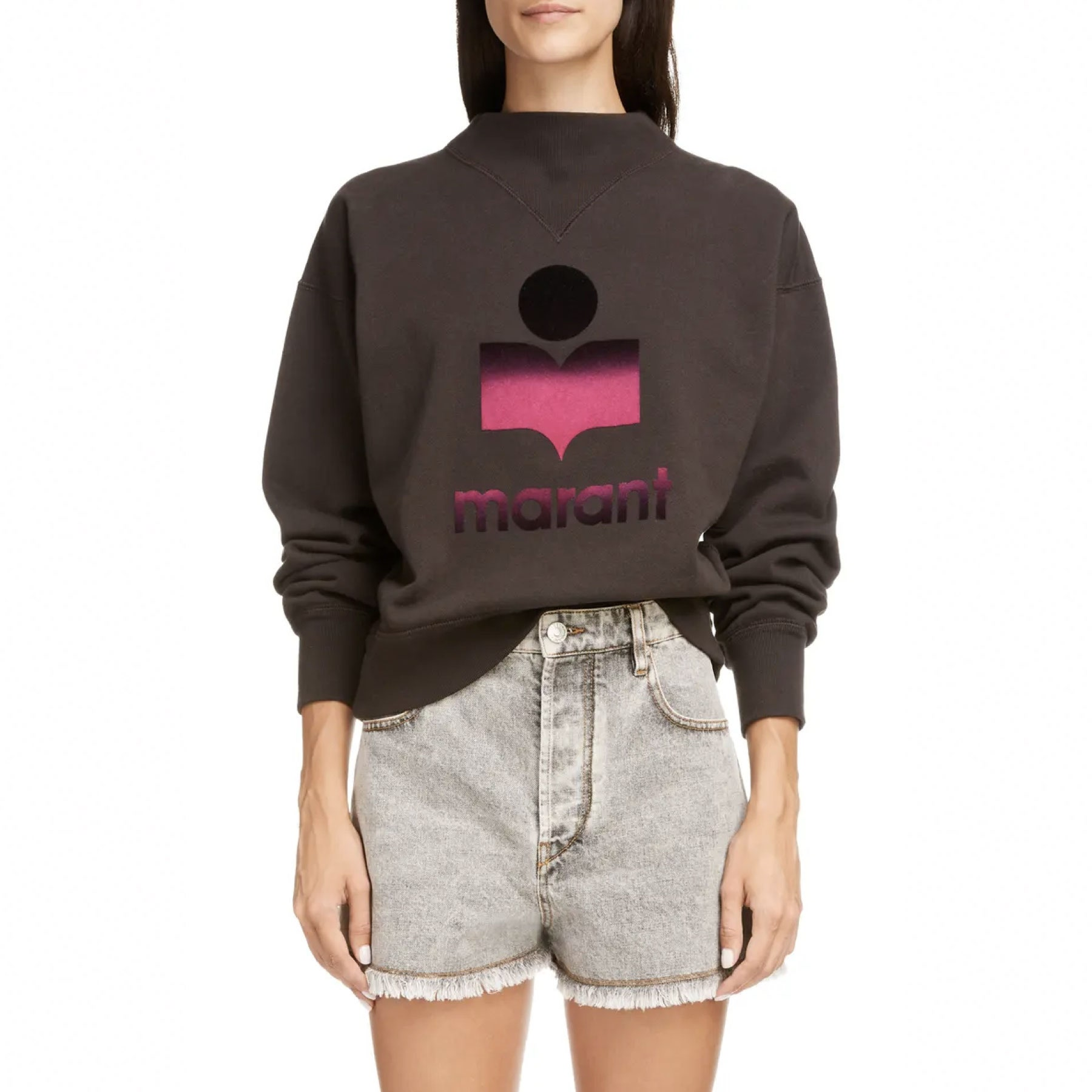 model wearing grey sweatshirt with pink and black logo