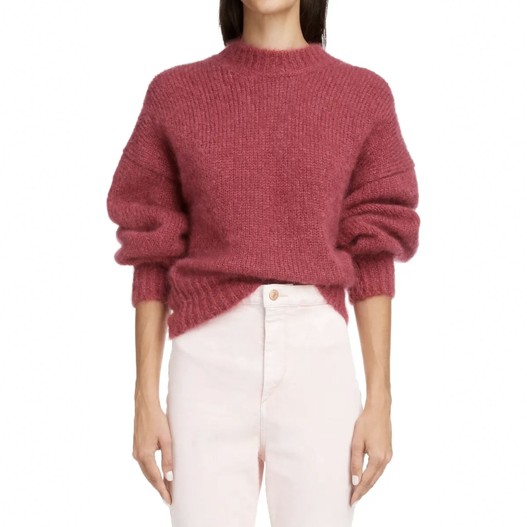 model wearing chunky pink sweater with white pants