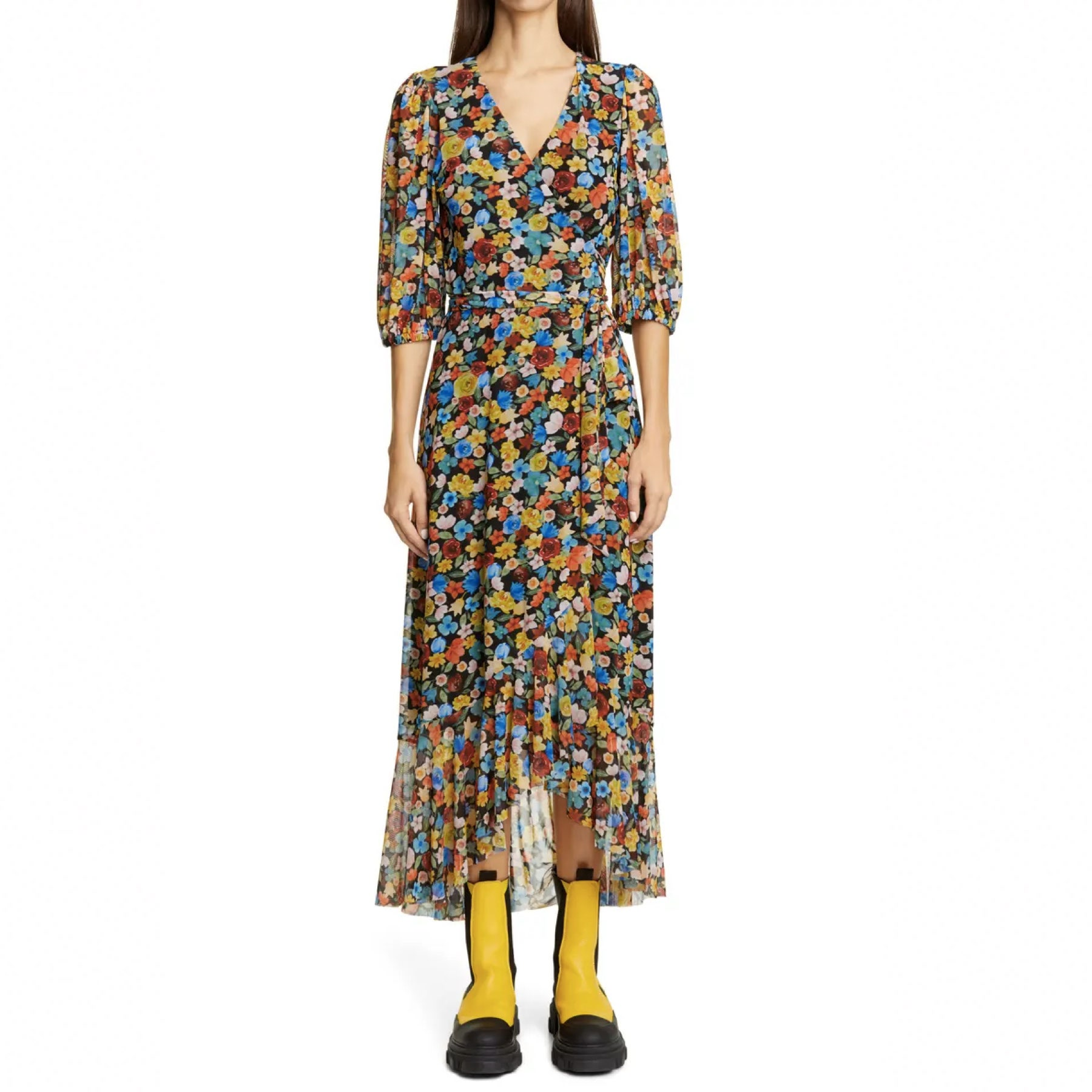 model wearing maxi floral dress and yellow boots