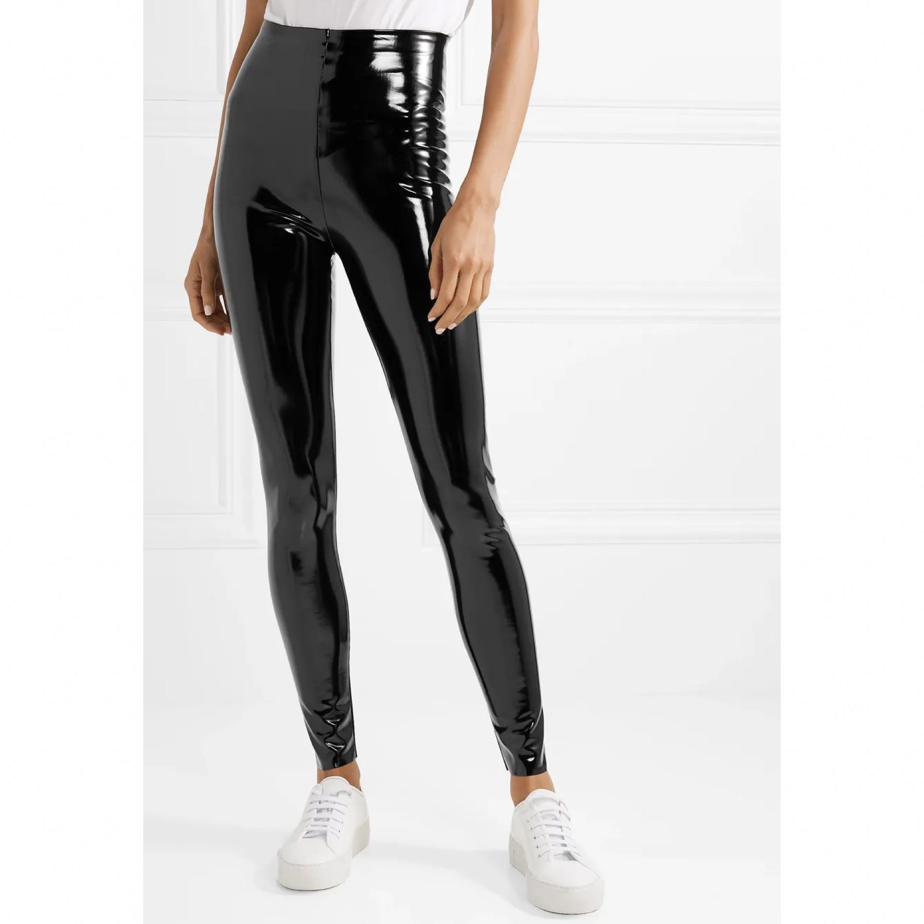 model wearing high-waisted patent leather leggings