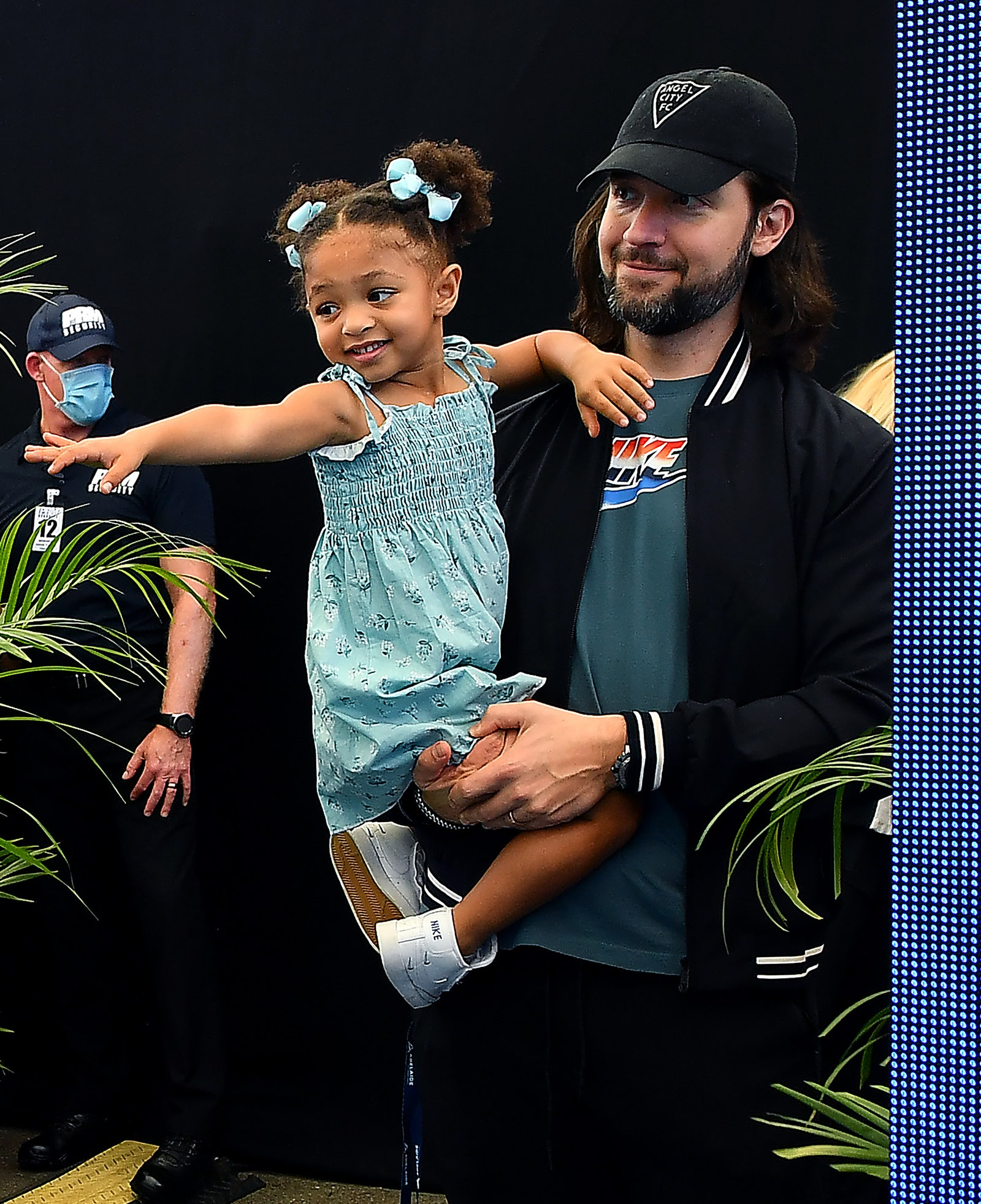 ADELAIDE AUSTRALIA JANUARY 29 Serena Williams of the USA daughter Alexis Olympia Ohanian Jr waits with dad Alexis...