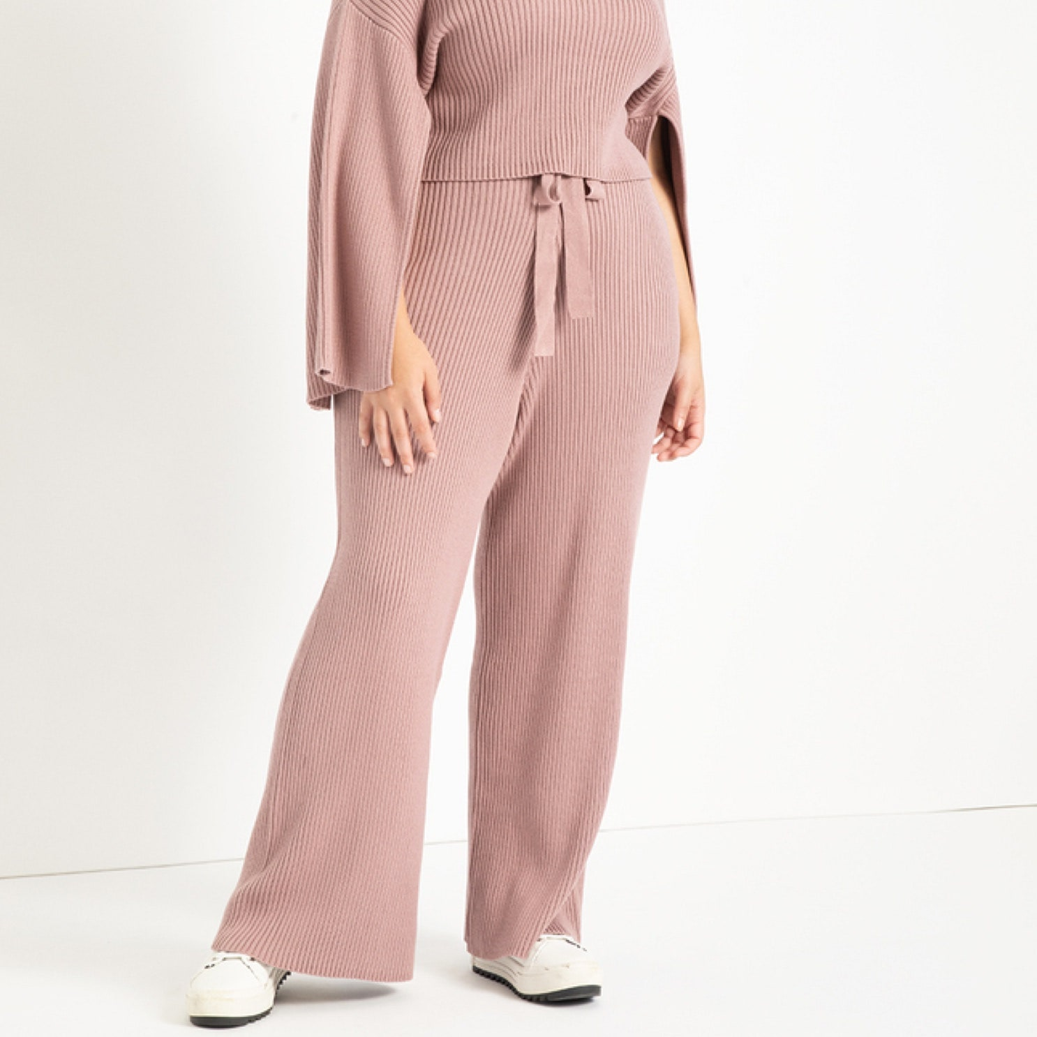 model wearing pink ribbed sweater pants
